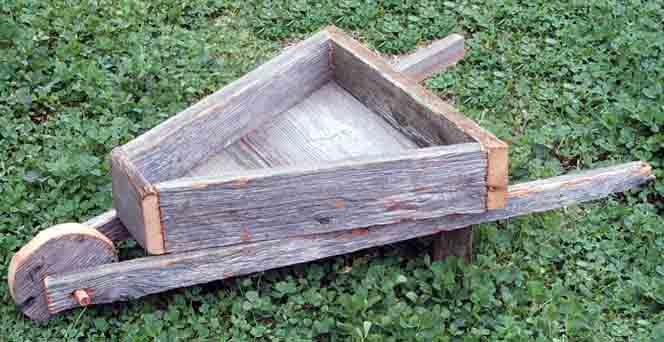Rusticbarnwood Jpg Our Rustic Barnwood Wheelbarrow Planter Box
